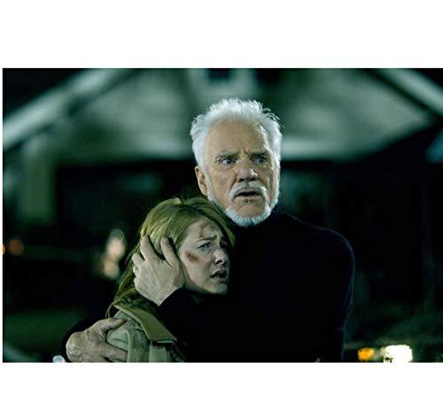 Halloween Malcolm McDowell as Dr. Loomis holding Danielle Harris as Annie 8 x 10 Inch Photo]()