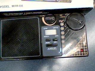 Travelers Clock Bands Radio Model. FM/AM Clock