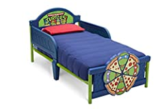 Make the transition to a big kid bed totally tubular with this Ninja Turtles 3D Toddler Bed from Delta Children! Both practical and playful, it features sleep rails at both sides, a colorful decal at the headboard and a three-dimensional foot...
