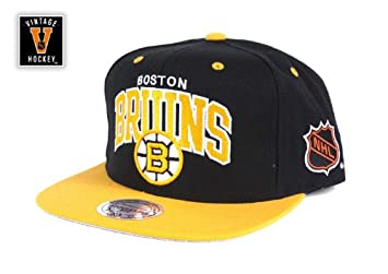 big sale 7b644 dae43 Mitchell y Ness Boston Bruins Team Arch gorra Snapback Cap  Amazon.es   Deportes y aire libre