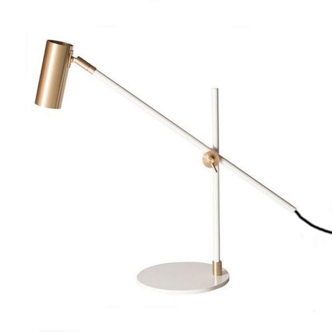 Posmoderna lámpara de mesa de lujo con luz dorada, modelo de ...