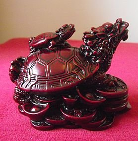 1 X Dragon Headed Turtle in a Dark Red Resin Finish with Baby Turtle on Shell and Standing on a bed of Coins and Gold Ingots; 8c