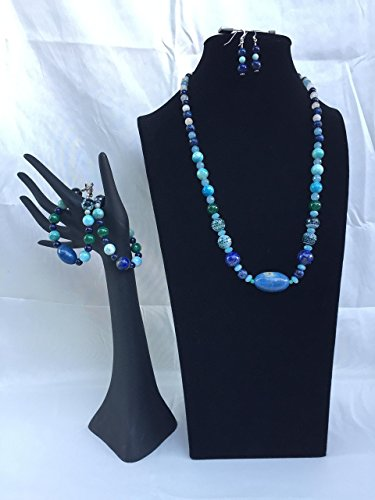 Wow factor handmade Lapis jewelry set with a necklace, two bracelets and matching dangle earrings. Large Lapis center bead with mixed gemstones. One of a kind by The Stonz Project