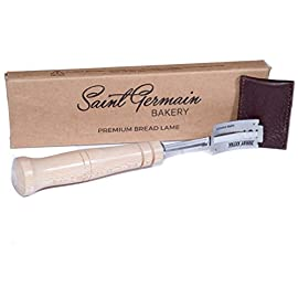 SAINT GERMAIN Premium Hand Crafted Bread Lame with 6 Blades Included - Best Dough Scoring Tool with Authentic Leather Protective Cover 8 PREMIUM QUALITY: Premium hand crafted wood handle with best quality stainless steel stick to attach replaceable blades. Built to last. METICULOUS CRAFTSMANSHIP: Beautifully designed to hold the lame firmly in place with a comfortable handle to achieve outstanding scoring results. REPLACEABLE BLADES: Blades are easily replaceable with standard razor blades (6 included).