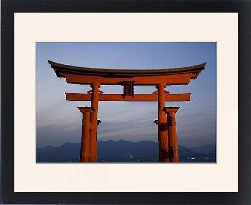 Framed Print of The vermillion coloured floating torii gate by Robert Harding