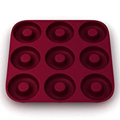 """Finally, a Durable and Flexible Commercial Grade Silicone Donut Pan that Creates Iconic Spherical Donuts!""  Looking for a Nonstick Silicone Donut Mold that's Ultra-Heat Resistant & Produces Beautiful Spherical Donuts? Well get ready to s..."