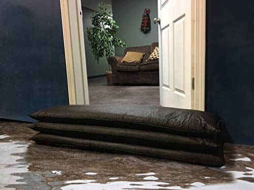 Flood Bags piled before a residential front door keeping the floodwater at bay.