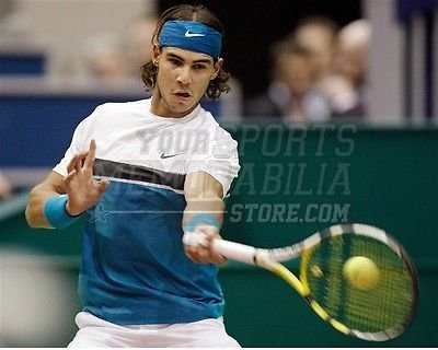 Amazon.com  Rafael Nadal forehand return blue headband 8x10 11x14 ... baf3618e8c9