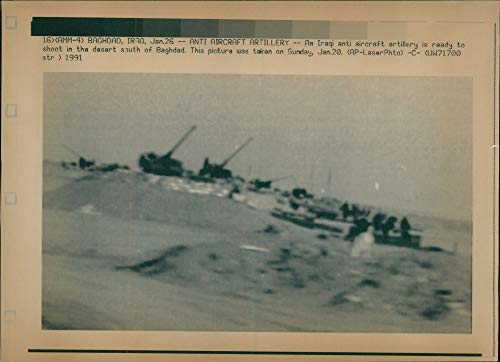 Vintage photo of Iraq bombing:an iraqi aircraft artirilly.