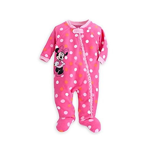 Nightwear and bedding for baby and toddler. Family at home. Young mother with her one years old little son dressed in pajamas are relaxing and playing in the bedroom at the weekend together, lazy morning, warm and cozy scene.