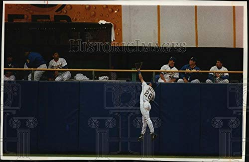 (Vintage Photos 1993 Press Photo Milwaukee Brewers bullpen scatters as Angels' Juan Bell Leaps)