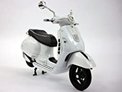 At 1/12 Scale the model can display some very nice details. The model itself is made of a combination die-cast metal for the front and plastic for the middle and back as well as the seat, wheels and details. The coloring and detail are very i...