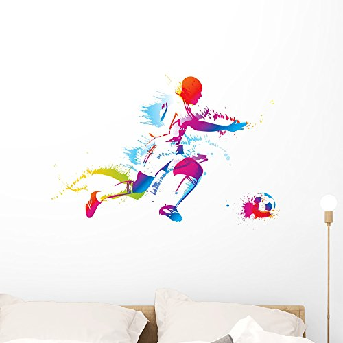 Wallmonkeys Soccer Player Kicks the Ball Wall Decal Peel and Stick Graphic WM244901 (36 in W x 25 in H) by Wallmonkeys
