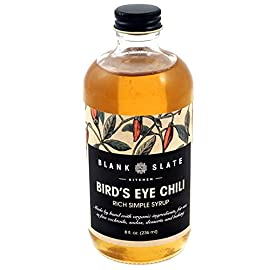 Bird's Eye Chili Rich Simple Syrup   by Blank Slate Kitchen   8 ounce   Cocktail Mixer or Dessert Topping 53 Craft Syrups for Creative Cocktails - This Blank Slate Kitchen syrup is the perfect complement to a wide variety of liquors to make many types of cocktails such as the Spicy Margarita, Angry Bee's Knees, Spicy Cowgirl, and more! Pure, Natural Flavoring - Crafted with natural, organic cane sugar and no artificial flavors or preservatives, our mixing syrups offer an exciting, fresh taste that pairs well with a variety of foods and drinks. Expanded Drink Flavor Profile - Bird's Eye Chili syrup mix can be used to enhance tea, cocktails, coffee, hot chocolate, or smoothies in your kitchen, home bar, or restaurant.