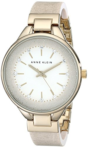 - Anne Klein Women's AK/1408CRCR Swarovski Crystal Accented Cream Bangle Watch