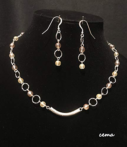 Necklace and earring set made of Pale yellow and orange frosted glass beads with silver rings