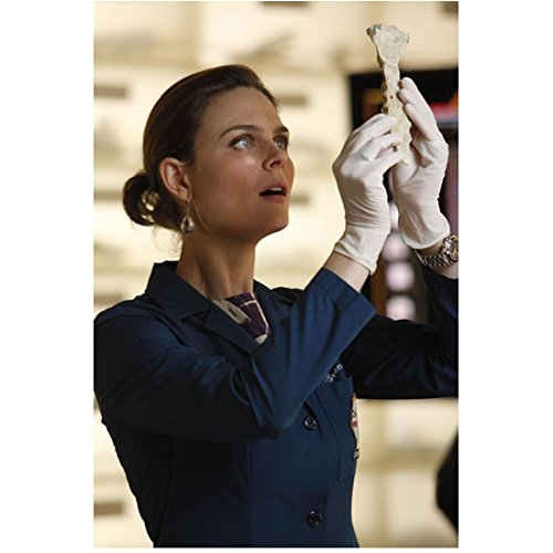 bones-tv-series-2005-8-inch-x10-inch-photo-emily-deschanel-in-blue-labcoat-holding-bone-up-in-air-ma