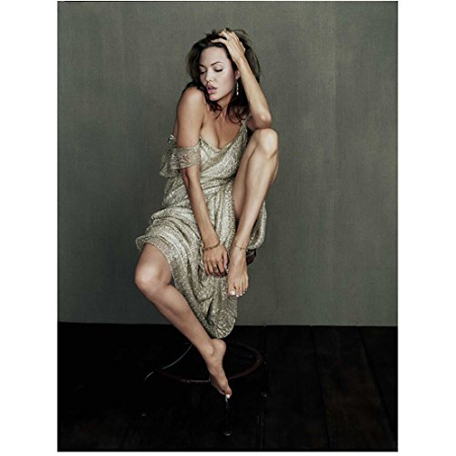 Angelina Jolie Wearing Printed Dress Falling Off Shoulder Sitting in Chair Barefoot Eyes Closed Head Turned Hand in Hair Mouth Open Foot on Seat 8 X 10 Inch Photo