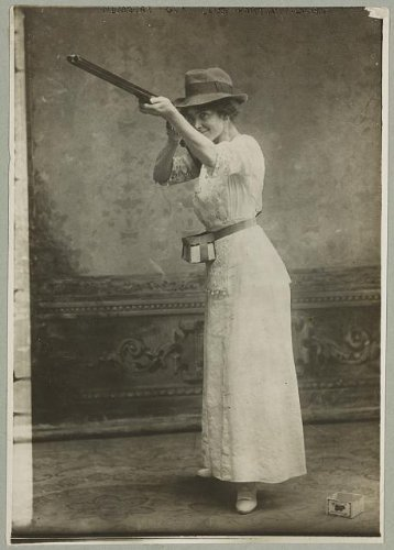 Photo: Woman posed with shotgun for trapshooting, shooting, wearing hat, 1914 . Size: 8x10 (approxim