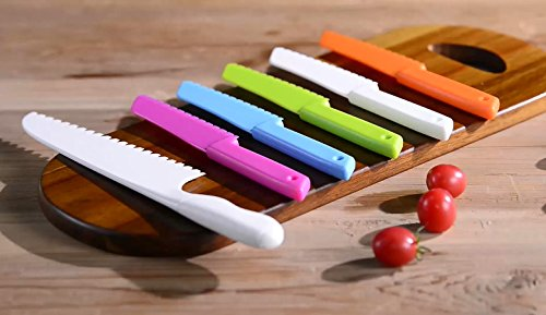 """ONUPGO 4-Piece Plastic Kitchen Knife Set with Serrated Cutting Edges - Kids Safe Chef Nylon Knife/Children's Cooking Knives for Fruit, Bread, Cake, Lettuce and Salad 7 PERFECT KIDS KNIFE SET: Size at: 7.87"""" X 1.18"""" (20cm x 3cm), with serrated cutting edges, blunt tips; ergonomic handles. This kitchen knife cooking tools designed specifically for kids to encourage culinary learning, bonding, and confidence, Getting kids involved in the kitchen from an early age means that they learn essential life skills that stick, not to mention a love of food and cooking. They will love this kid cooking set and so will you! BEAUTIFUL COLORS: Your kids will be desperate to join you in the kitchen. Packing includes 4 Piece kids safe knives set.The new colors kid's knives set can help you create delicious dishes. Finding a common interest with your kid, make memories together and fosters healthy life skills. DESIGNED FOR KIDS: Kid knives with safe serrated cutting edges that WON'T CUT SKIN! Knife safely cut many types of fruit, lettuce, vegetables, bread, cheese, cake, carrots, zucchini, strawberries and more (except some other meat). They are safe for little hands, appropriate for young gastronomic apprentices ages 4 and up."""