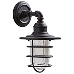 An Amazon Brand - The black iron steel housing and mount for this classic industrial wall sconce is paired with a matching metal cage over a ribbed glass shade to complete the aesthetic.