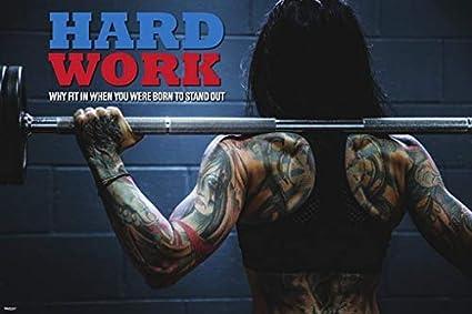 Amazon tattoo woman hard work gym body building fitness