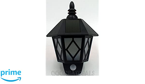Kingavon Solar - Farol de pared para exterior (con sensor de movimiento, color negro: Amazon.es: Iluminación