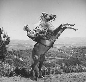 Photo Movie cowboy Roy Rogers posing on top of his horse Trigger 1943