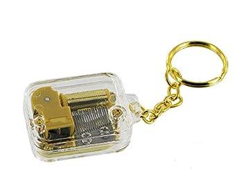 Llavero musical de plexiglás y metal dorado con mecanismo ...