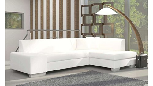 divano letto angolare in pelle bianca, con tappeto grigio.