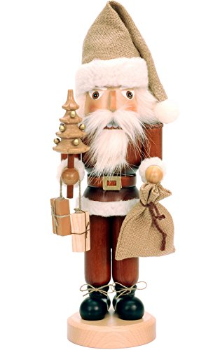 Alexander Taron Importer 32-333 This Ulbricht/Seiffener Santa Nutcracker Is Holding a Christmas Tree an d a Sack Of Presents an d Is in  Natural Wood Finish.