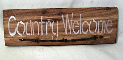 - Country Welcome Reclaimed Wood Sign with Barbed Wire Embellishment.