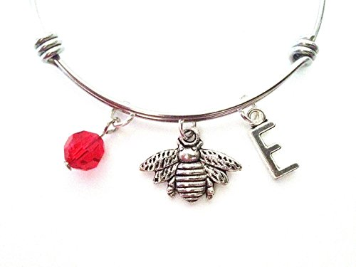 Honey bee themed personalized bangle bracelet. Antique silver charms and a genuine Swarovski birthstone colored element.