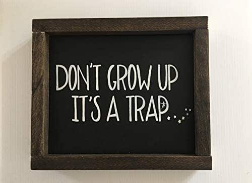 Don't Grow Up, It's a Trap Wood Framed Sign