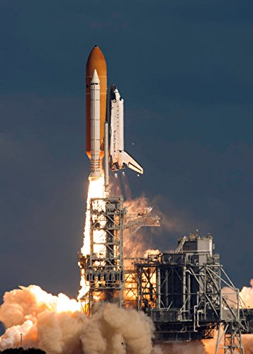 Space Shuttle Atlantis clears the tower at the Kennedy Space Center Florida Poster Print by Rob EdgcumbeStocktrek Images (11 x 17)