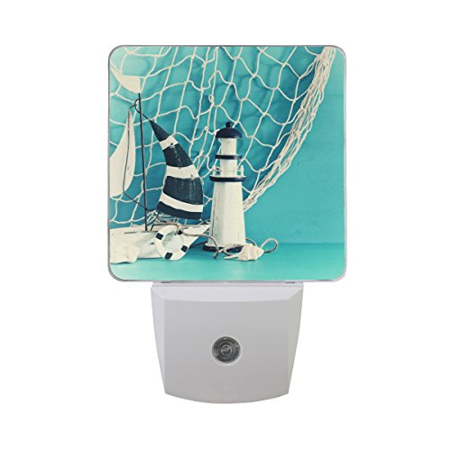 Naanle Set of 2 Nautical Theme Sailboat Lighthouse Seashells Fishnet Over Blue Wooden Table Vintage White Decorative Auto Sensor LED Dusk to Dawn Night Light Plug in Indoor for Adults