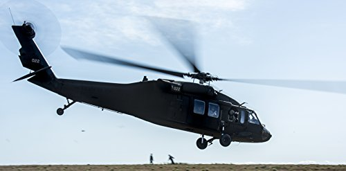 LAMINATED POSTER A U.S. Army UH-60 Black Hawk takes off for