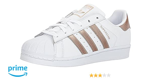 outlet store 6b0c3 b7d70 Amazon.com   adidas Originals Women s Superstar Shoes Running Cyber Metallic White,  8 M US   Fashion Sneakers