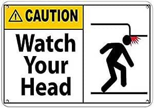 Geniol Pierced Head metal tin sign at home decor store
