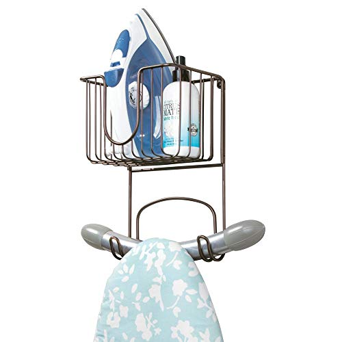 (mDesign Wall Mount Metal Ironing Board Holder with Small Storage Basket - Holds Iron, Board, Spray Bottles, Starch, Fabric Refresher for Laundry Rooms - Bronze)