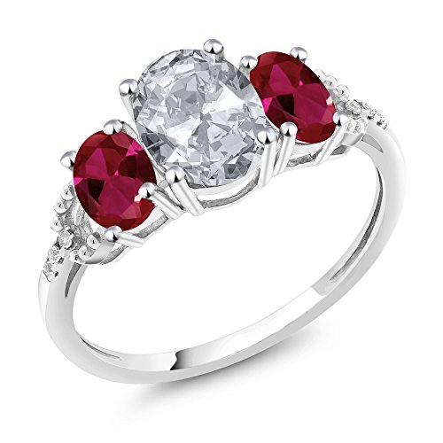 Gem Stone King 10K White Gold Diamond Accent 3-Stone Engagement Ring set with 2.35 Ct Oval White Topaz Red Created Ruby (Size 6) ()