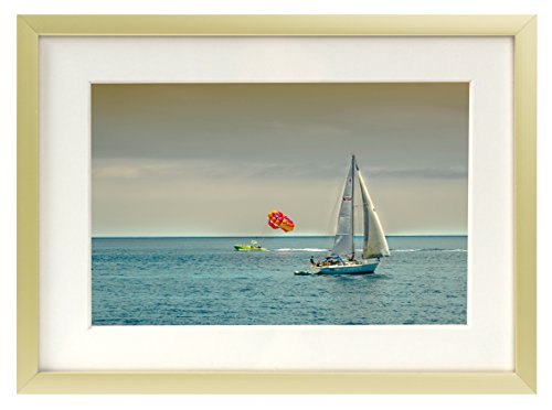 Frametory, 5x7 Gold Aluminum Frame - Ivory Color Mat for 4x6 Picture - Real Glass - Easel Stand - Wall Mounting Hardware Included