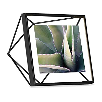 Umbra Prisma Picture Frame, 4x4 Photo Display for Desk or Wall, Black - THE ORIGINAL GEOMETRIC WIRE PICTURE FRAME: Designed by Sung Wook Park for Umbra, Prisma is the original geometric wire photo frame MODERN PHOTO FRAME: Prisma's geometric shape picture frames are both decorative and functional. Whether you choose to display them vertically or horizontally, on a table top or hung on your wall, Prisma adds a dimensional component to an otherwise flat picture display FLOATING IMAGE DESIGN: Prisma's innovative design floats your photo between two panes of glass, while allowing the geometric frame to show through. This creates an impressive, eye-catching display for your favorite photos - picture-frames, bedroom-decor, bedroom - 4171mFLJiUL. SS400  -
