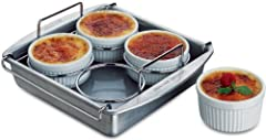 Crème Brulee, a decadent treat usually reserved for fine restaurant dining can now be easily and safely prepared at home with this clever set from Chicago Metallic. The set includes an 8-inch square aluminized steel baking pan, chrome wire ra...