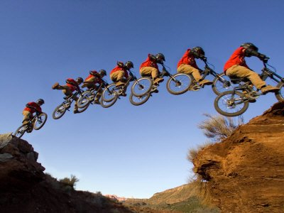 Mountain Biker Catches Air at Rampage Site near Virgin, Utah, USA Photographic Poster Print by Chuck Haney, - Rampage Air