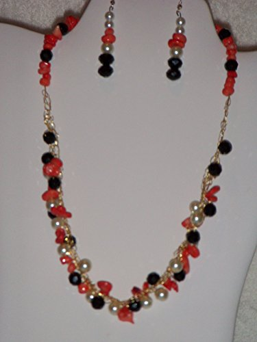 Gold colored Crocheted Wire, Orange Nugget Chip beads, White Simulated Mother of Pearl, beads, and Black Rondelle Beads Bib Necklace SetwMatching Earrings