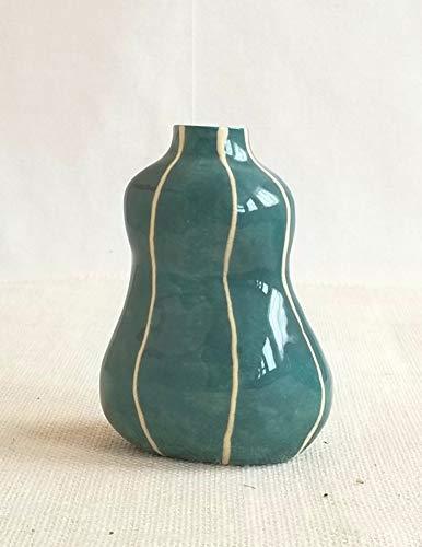 (VIT ceramics bud vase from Kri Kri Studio, small handmade torso shaped flower vase. Turquoise blue with raised white stripes.)