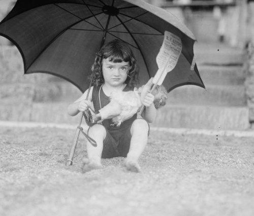 1923 June 28. photograph of Girl in bathing suit holding umbrella, 6/28/23 Vi b4