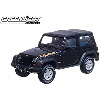 Amazon.com: 2010 Jeep Wrangler Islander 1/43 Black: Toys & Games