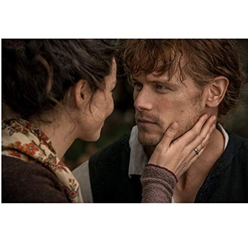 Outlander Caitriona Balfe as Claire Randall Looking at Sam Heughan